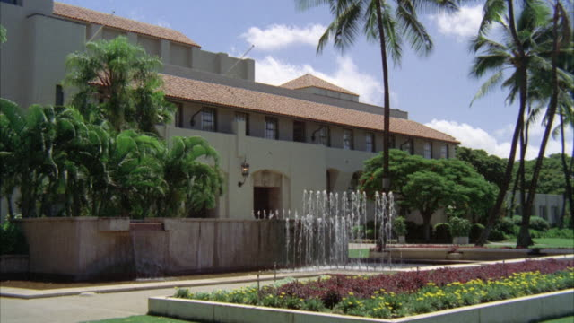 MS Fountain in front of Apartment building, school, mansion, government building, palm trees