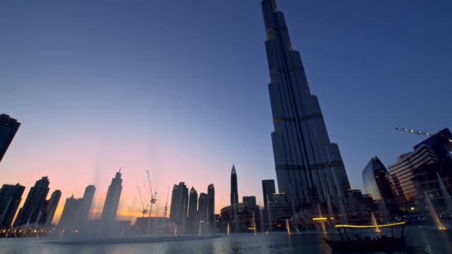 fountain in front of the burj khalifa - arts culture and entertainment stock videos & royalty-free footage