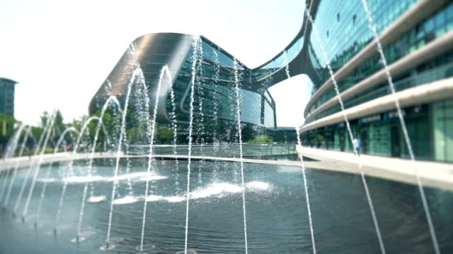 fountain in front of the modern landmark building at Shanghai city.