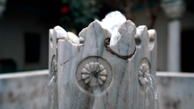 fountain in mosque madrasah garden - gazanfer agha madrasah - madressa stock videos and b-roll footage