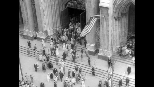 fountain in new york city / the faithful line up outside st thomas' church / ext st patrick's cathedral / people coming out of church as seen from... - st. patrick's cathedral manhattan stock videos and b-roll footage