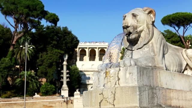 Fountain in Piazza del Popolo in Rome and terrace of Pincio hill