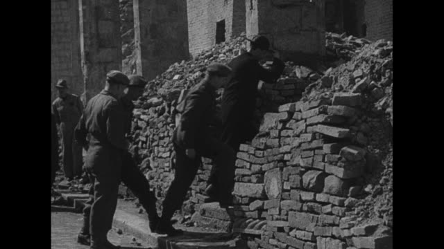 fountain in square in front of rubble of the basilica of st thomas the apostle in ortona italy / half of sacristy standing / priest leads canadian... - 1944 stock-videos und b-roll-filmmaterial