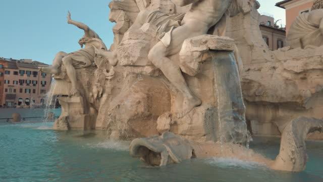 fountain of the four rivers, piazza navona, rome, italy - cultura italiana video stock e b–roll