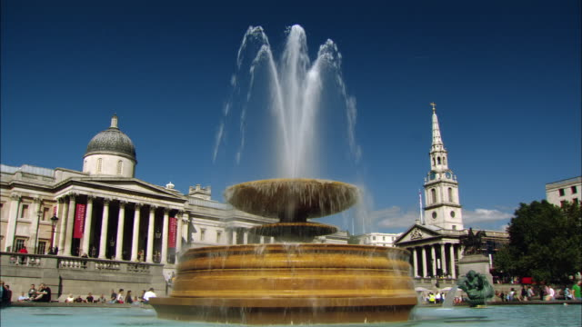 MS fountain on Trafalgar Square and National Gallery, London, England