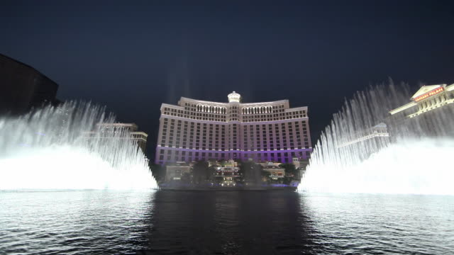 WS Fountain outside Bellagio hotel and Casino at night / Las Vegas, Nevada, USA