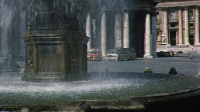 A fountain plays in front of St. Peter's Basilica in Vatican City.
