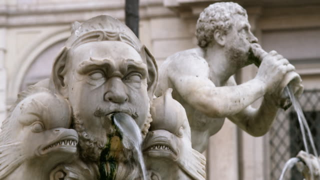 CU Fountain sculptures spitting out water / Rome, Italy