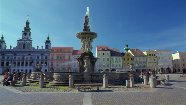 a fountain spouts water in a city plaza in the czech republic. - czech republic stock videos & royalty-free footage