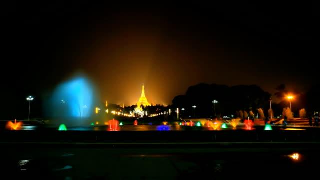 fountain with colorful illuminations at night near the Shwedagon Pagoda