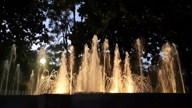 fountain with light in the dark. - fountain stock videos and b-roll footage