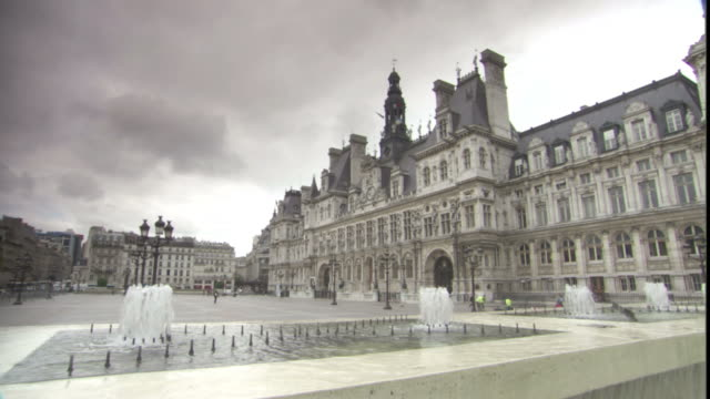 fountains splash in front of the hotel de ville in paris. - hotel de ville paris stock videos & royalty-free footage