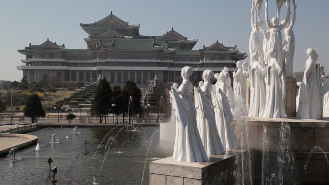 Fountains spout by statues at the pool in front of the Grand People's Study House in Pyongyang.