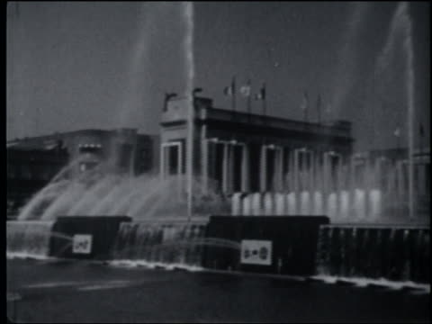 pan fountains with buildings in background at brussels world's fair - 1958 stock videos & royalty-free footage