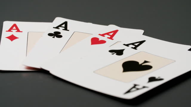 ms four ace playing cards thrown on table - four objects stock videos & royalty-free footage