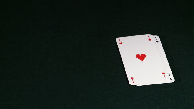 vídeos de stock, filmes e b-roll de ms slo mo four aces playing cards being fallen against / vieux pont, normandy,  france - pôquer