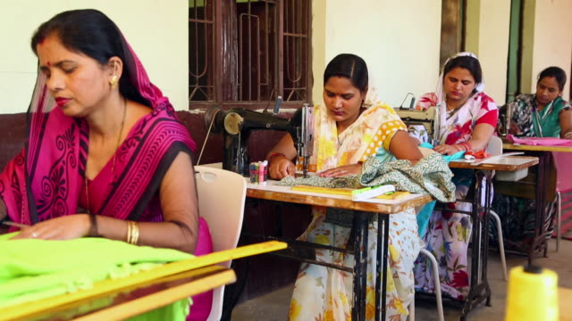 vidéos et rushes de four adult women sewing clothes, sonipat, haryana, india - indien d'inde