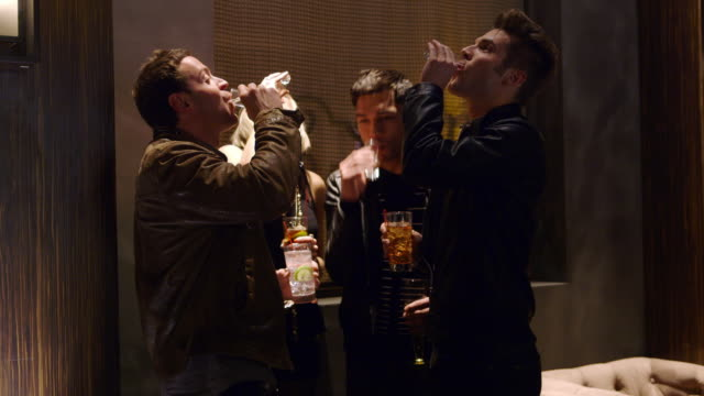 ms four adults toasting and drinking shot glasses - whiskey stock videos and b-roll footage