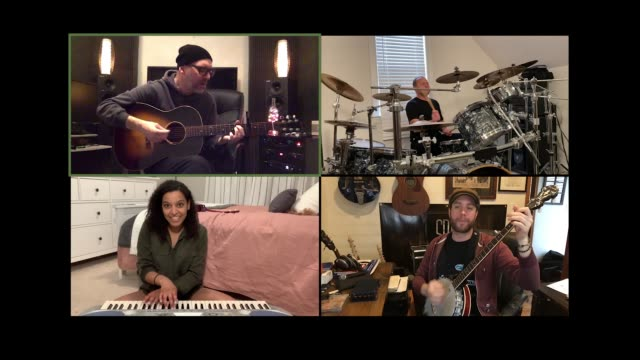 four bandmates remotely practice playing music together via video call. - musician stock videos & royalty-free footage