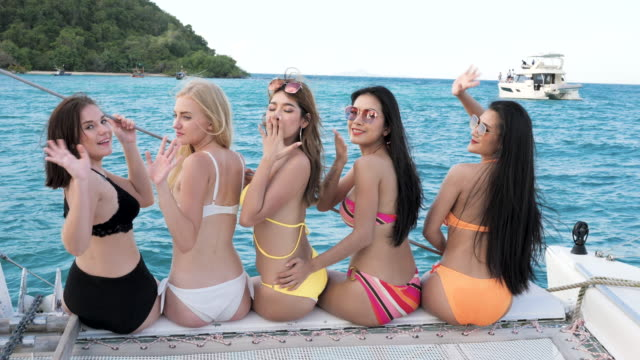four beautiful girls have a party on a yacht - swimwear stock videos & royalty-free footage