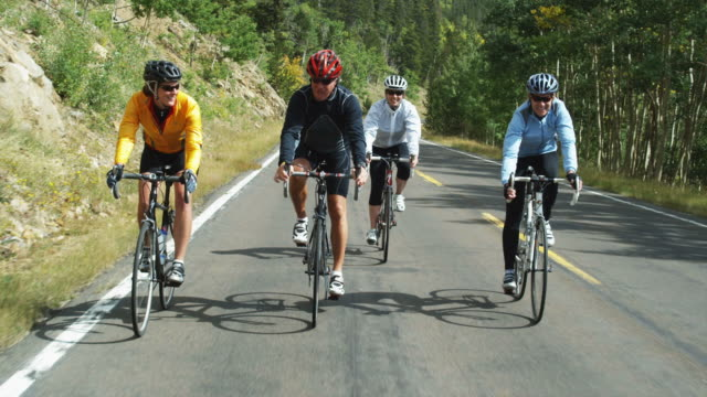 four bikers coming down a mountain road