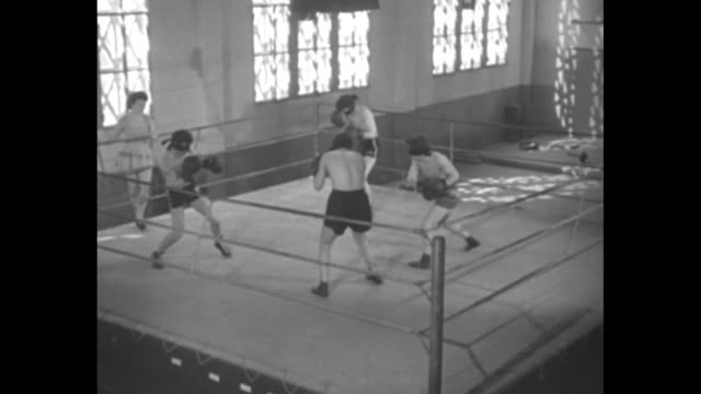 vs four boxers in boxing ring fighting with blindfolds on woman at ringside watching / close shot of woman at ringside watching laughing / boxers... - blindfold stock videos & royalty-free footage