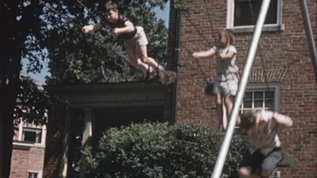 1956 ms four boys on swing set / usa - 1950 stock videos and b-roll footage