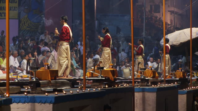 four Brahmin Priests  with bells and incense