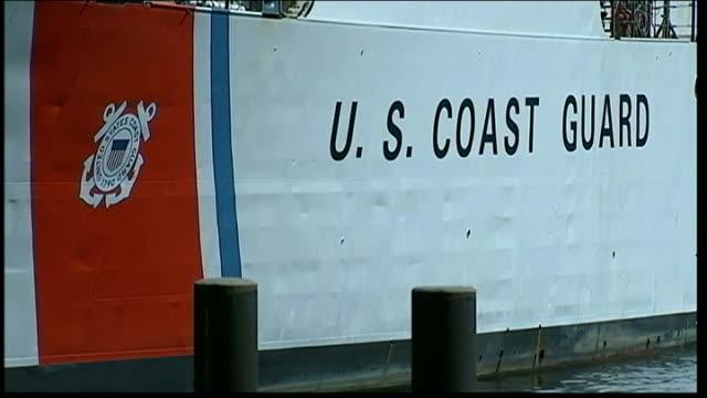 search continues usa massachusetts boston coast guard ships in moored in dock close shots of crew on deck of moored us coast guard search ship - セーリングチーム点の映像素材/bロール