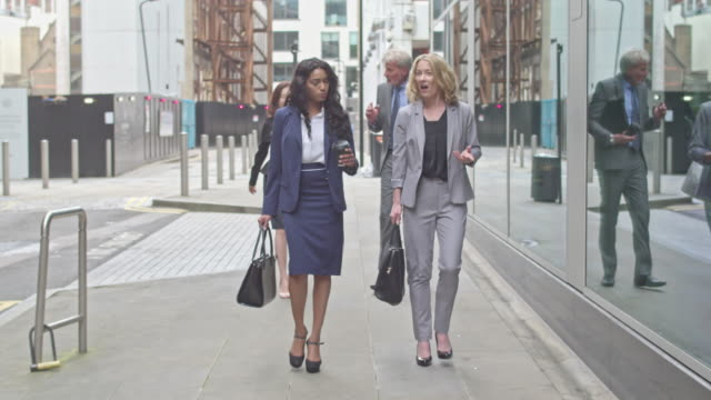 four business people commuting to work - businesswoman stock videos & royalty-free footage
