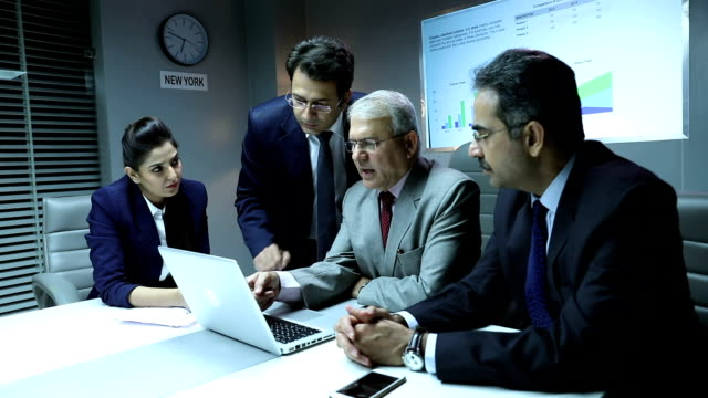 four business people doing meeting in the office, delhi, india - colleague stock videos & royalty-free footage