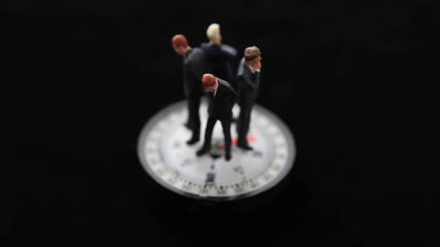 MS Four businessman figure on compass  / Shibuya, Tokya, Japan