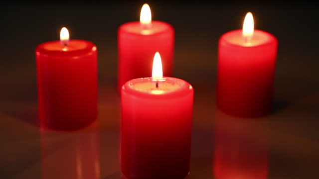 stockvideo's en b-roll-footage met four candles with a lit flame. movement from back to front. christmas time - vier dingen