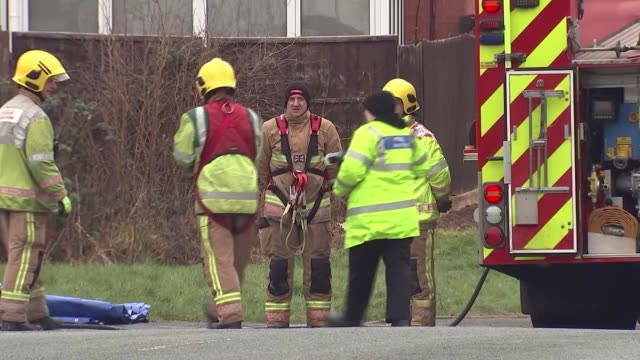 four children die in house fire in stafford; england: staffordshire: stafford: ext blue police tape cordon tied around tree firefighters along floral... - tree hugging stock videos & royalty-free footage