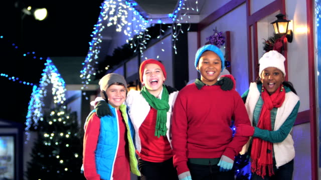 four children having fun at winter festival - 10 11 years stock videos & royalty-free footage