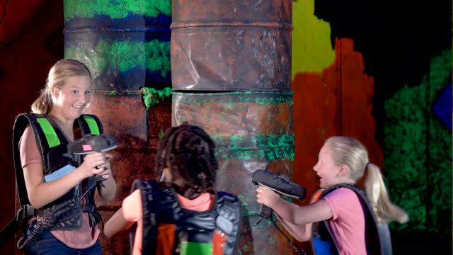 four children playing laser tag - 14 15 years stock videos & royalty-free footage