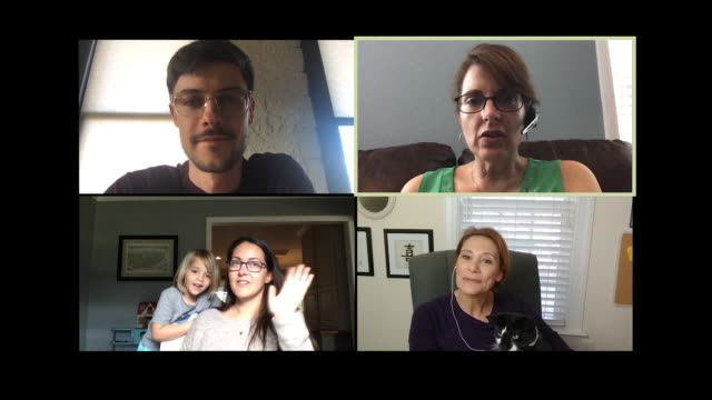 four colleagues working from home begin a video conference call. - video call stock videos & royalty-free footage