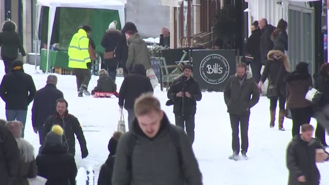 four die in hazardous conditions as snow sweeps the country england kent maidstone various shots people struggling to move cars on slushy roads... - cobham surrey stock videos and b-roll footage