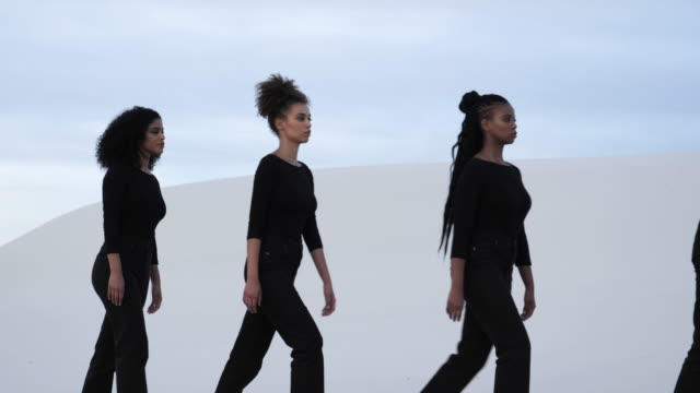 four diverse woman stand in desert - four in a row stock videos & royalty-free footage