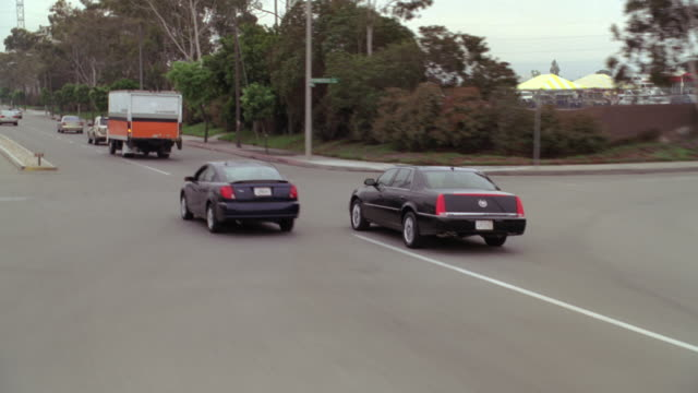 ms four door cadillac driving erratic and weaving through traffic - danger stock videos & royalty-free footage