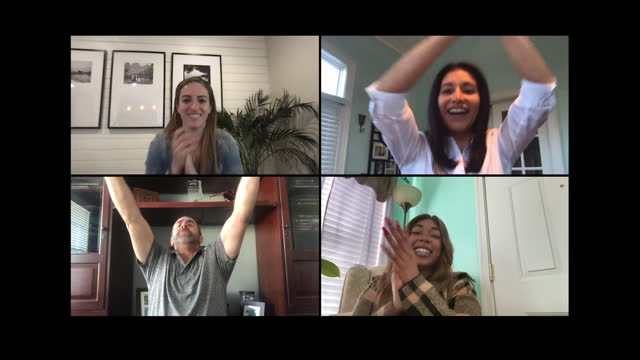 four excited individuals cheer while watching a sports game over a video call - four people stock videos & royalty-free footage