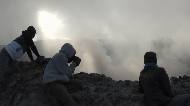 four experts from dr congo's goma volcano observatory take the trail to the summit of mount nyiragongo, whose volcano erupted on may 22, spewing... - lava stock videos & royalty-free footage