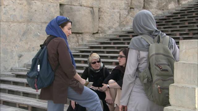 MS Four female tourists talking, Persepolis, Iran
