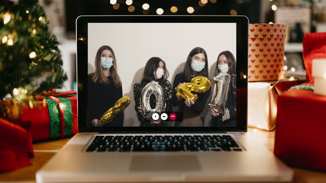 four friends celebrating 2021 new year's eve together during a video call - new year's eve stock videos & royalty-free footage
