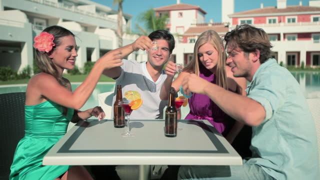 vídeos de stock, filmes e b-roll de four friends drinking shots on vacation - desaparecer gradualmente