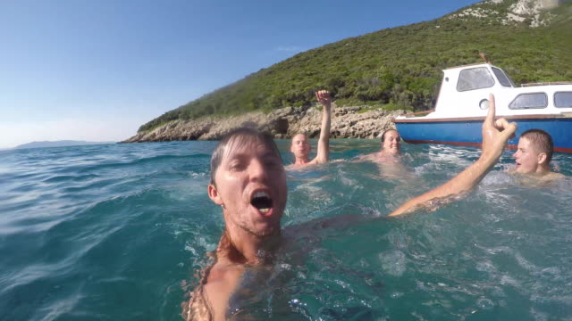 POV Four friends having fun in the water