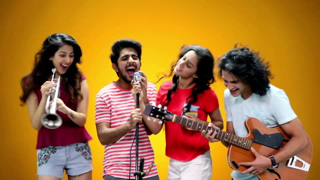 Four friends performing