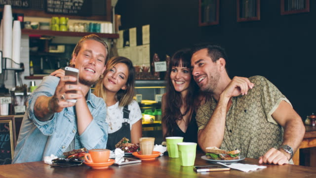four friends taking a selfie at the coffee shop - candid stock videos & royalty-free footage