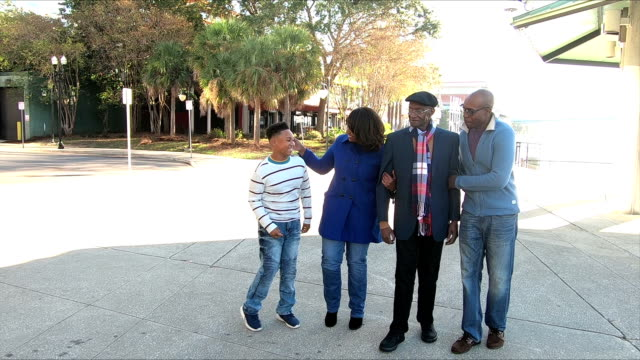 Four generation African-American family walking