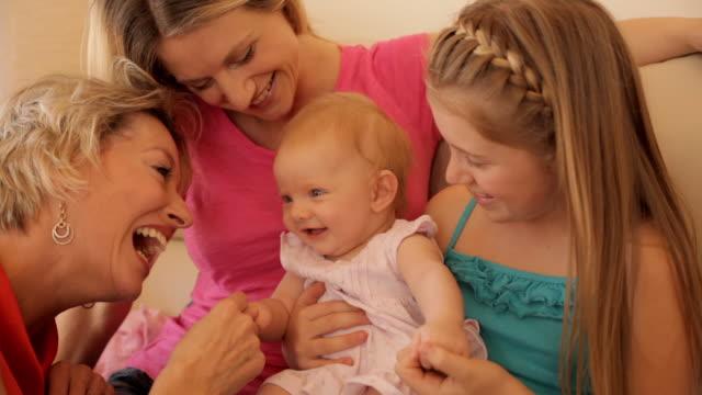 four generations of females sitting on sofa together. - 生後2ヶ月から5ヶ月点の映像素材/bロール